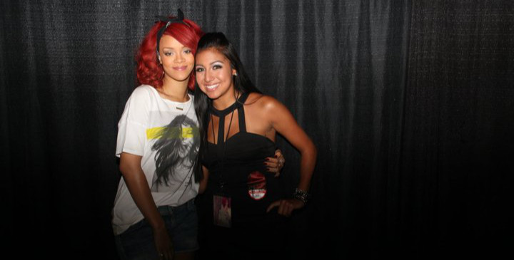 Rihanna posing with a fan