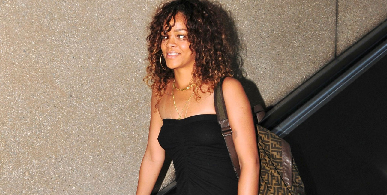 Rihanna in black dress and Fendi backpack