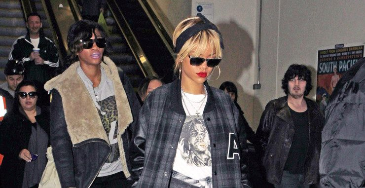 Rihanna in London wearing a varsity jacket