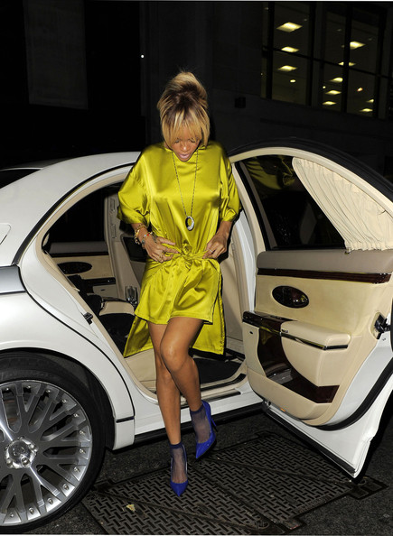 Rihanna yellow Adam Selman satin dress, Giles x Culter and Gross Scoobies sunglasses, Jimmy Choo blue pumps