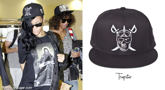 Rihanna in Givenchy t-shirt and Trapstar riders skull hat