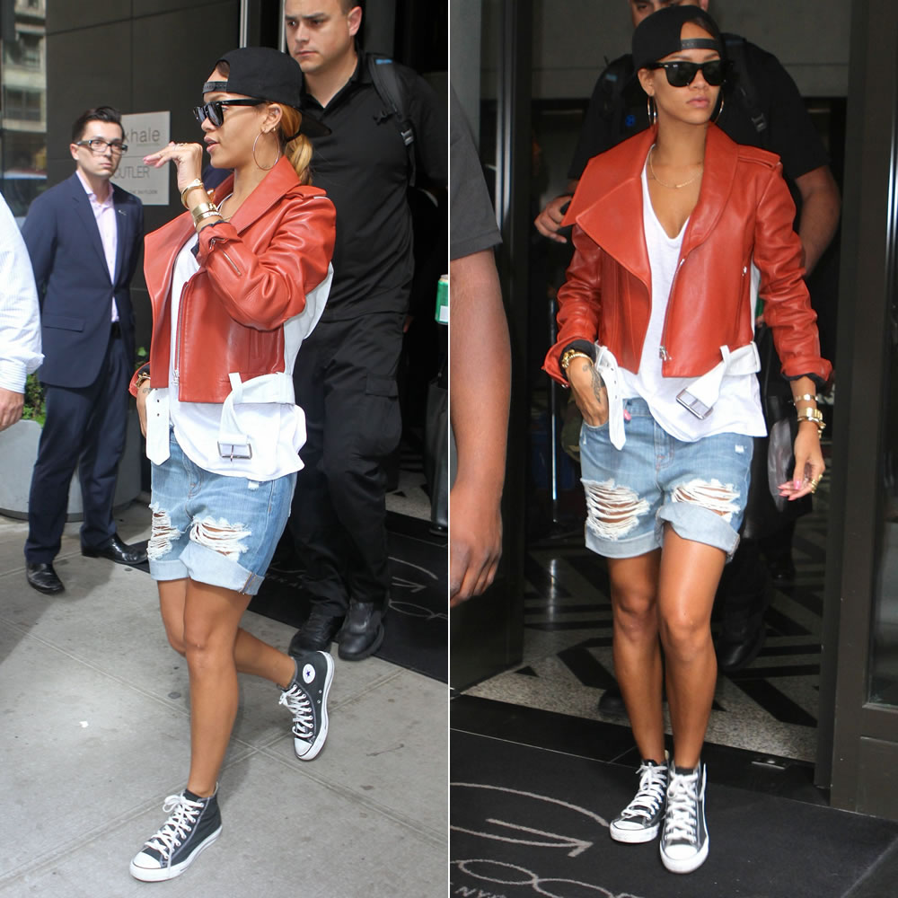 Rihanna in Thierry Mugler orange and white two tone leather jacket, J Brand distressed boyfriend shorts, Ray-Ban wayfarer sunglasses, Converse high top sneakers