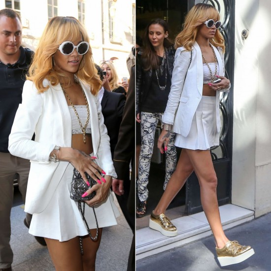 Rihanna in Paris wearing Rag & Bone white Jefferson blazer, Chanel gold platform oxfords, Chanel white round sunglasses, Free People stretch lace bandeau top