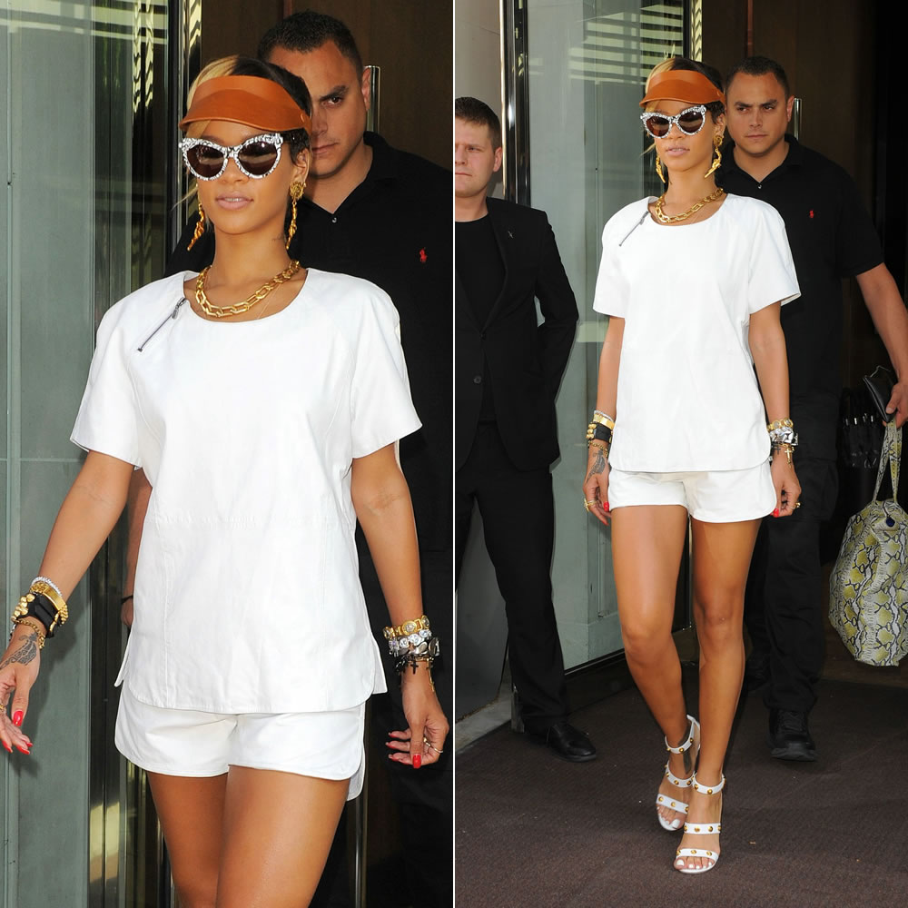 Rihanna in Designers' Remix AW2013 white leather shirt and shorts, Versace Medusa sandals, Fleet Ilya visor, Chanel gun earrings, Fallon spike rings, Balenciaga giant stud leather bracelet, Lynn Ban cross charm bracelets, Zanzan Erzulie mixed print sunglasses