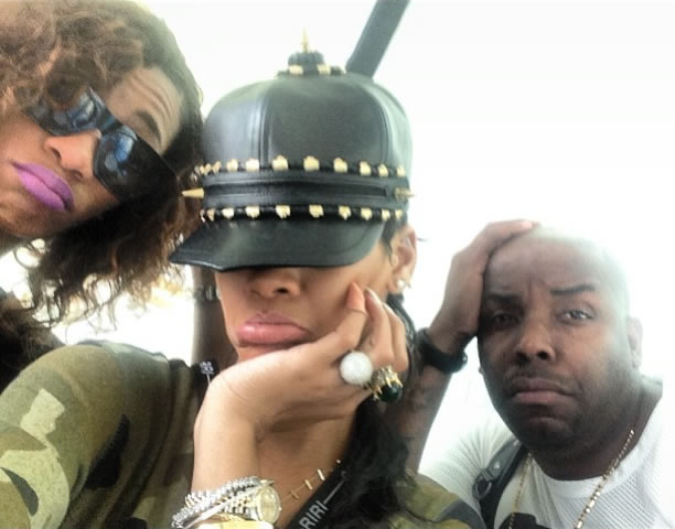 Rihanna in House of Malakai spiked equestrian hat, Rihanna for River Island camouflage jumpsuit, Jennifer Meyer cross bar necklace