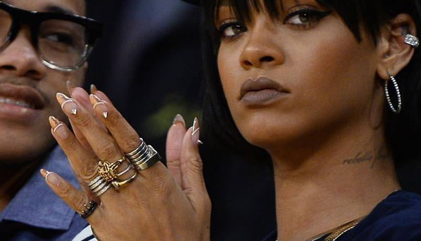 Rihanna wearing gold French tips and spike studs