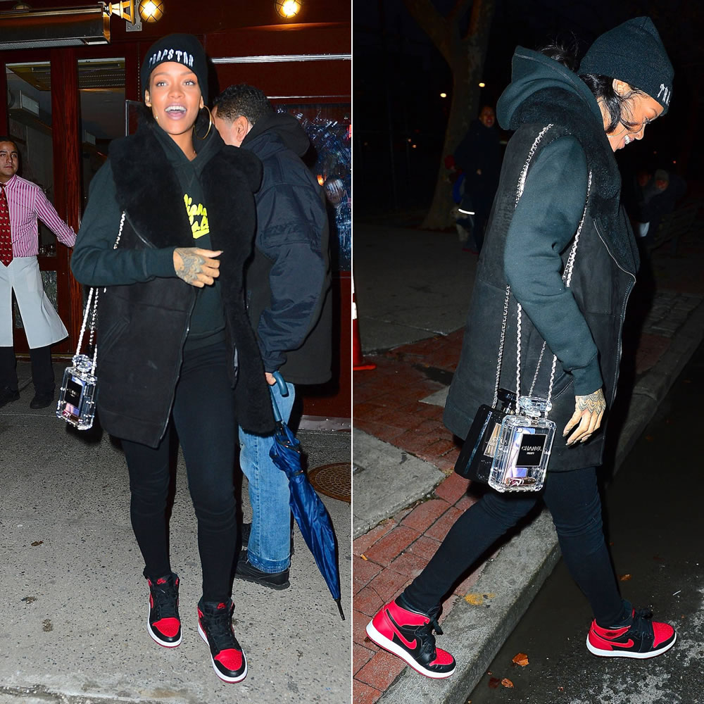 Rihanna wearing Trapstar Irongate hoodie, Billionaire Girls Club script chaser hoodie, Air Jordan 1 sneakers, Chanel perfume shaped bags