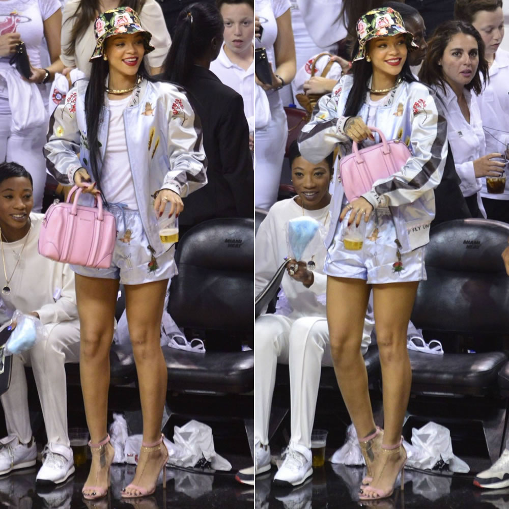 Rihanna at Miami Heat basketball game wearing Joyrich bucket hat and Bernard Wilhelm bomber jacket and shorts with Manolo Blahnik Chaos sandals