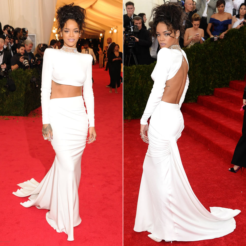 Rihanna at the 2014 Costume Institue Met Gala in white Stella McCartney croppted top and skirt, Christian Louboutin pumps, Jacob & Co diamond studs and choker
