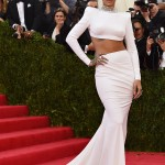 Rihanna wearing white Stelal McCartney crop top and skirt at the 2014 Met Gala