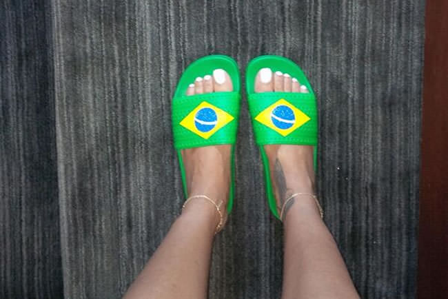 Rihanna wearing adidas Originals Adilette Brazil flag slides