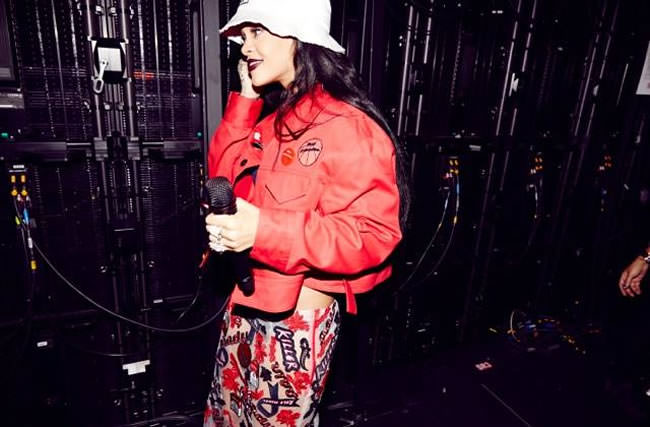 Rihanna wearing Hyein Seo white bucket hat, red jacket and PVC patch skirt during The Monster Tour in New Jersey