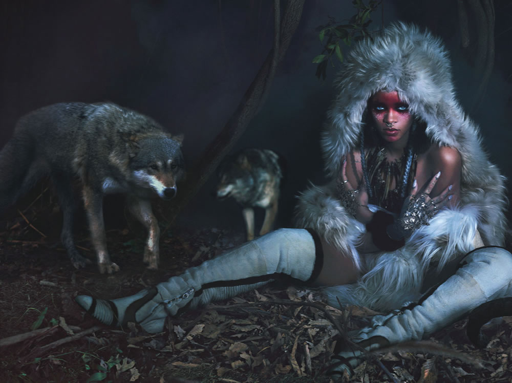 Rihanna in W Magazine September 2014 wearing Alexander McQueen Fall 2014 fur coat and hand bracelets, Marc Jacobs Fall 2014 boots