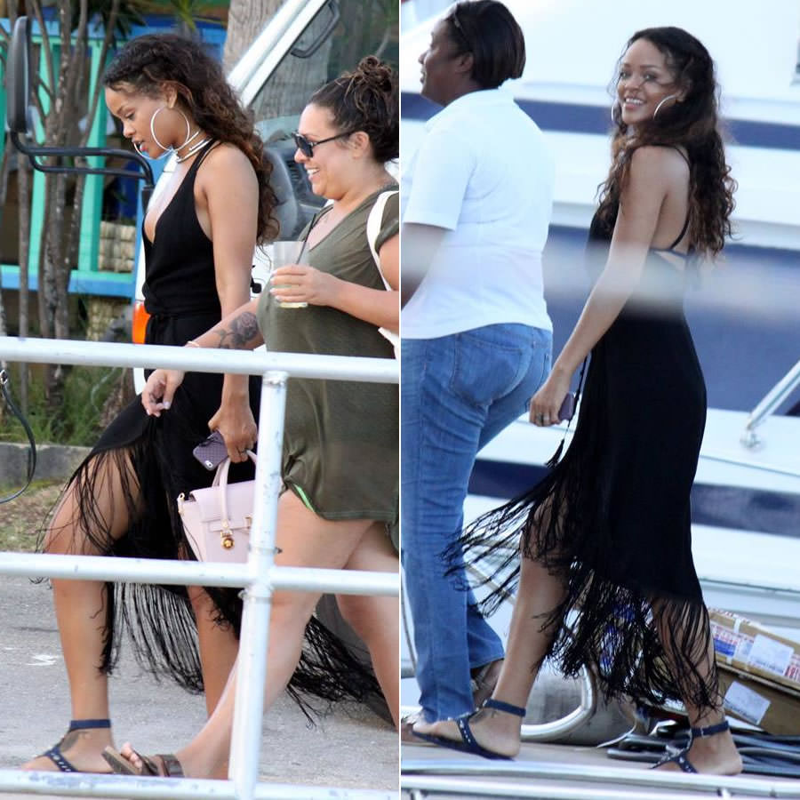 Rihanna in Reformation Henna black fringe dress, Charlie by Matthew Zink Paulina black bikini, Miu Miu crystal-embellished flat suede sandals, Versace small pink satchel