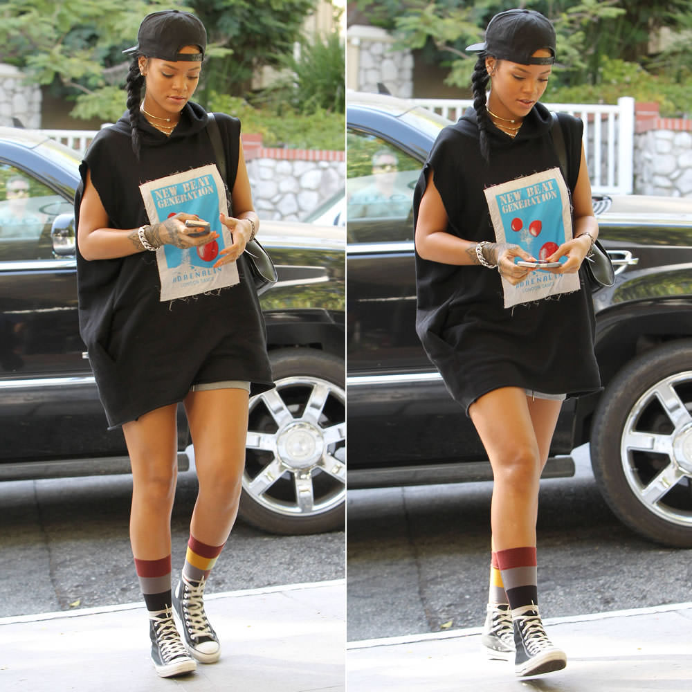 Rihanna wearing Givenchy black baseball cap, Martine Rose Fall 2014 black sleeveless hoodie, Stance Pixel socks, Converse black high-top sneakers, Inez and Vinoodh pearl necklace, Nektar de Stagni pearl choker, Jennifer Fisher ID bracelet, Reece Hudson Siren backpack