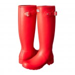 Hunter Original Tour boots in bright coral red as seen on Rihanna