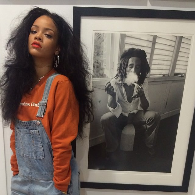Rihanna wearing Gentlem3ns' Club orange sweatshirt, Topshop Moto bleach dungarees