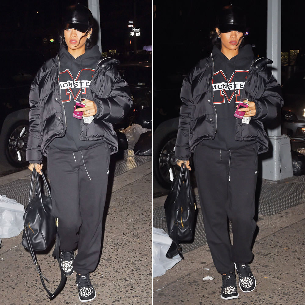 Rihanna wearing Vianel leather baseball cap, Monster Tour pullover hoodie, adidas black sweatpants, Nike Free 5.0 shield reflective leopard sneakers