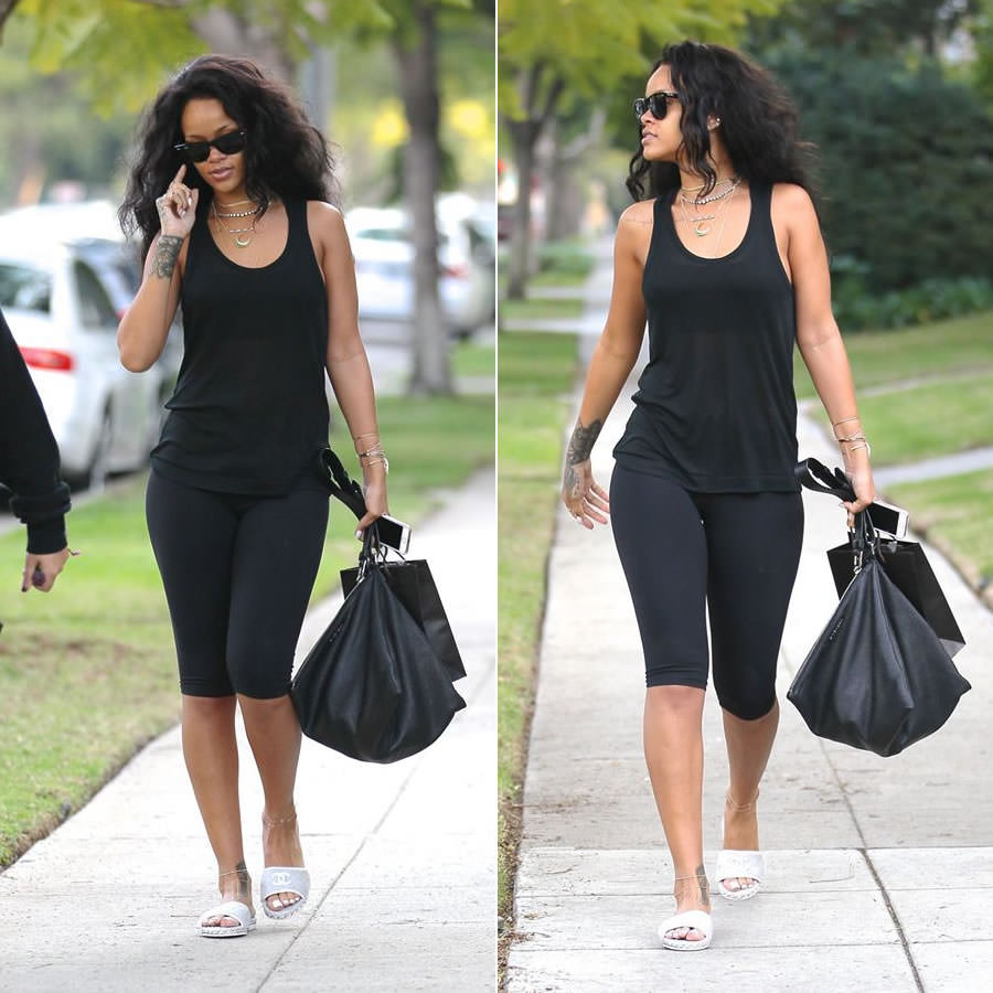Rihanna wearing Ray-Ban Wayfarer sunglasses, Chanel terry chain slide sandals, Givenchy black leather pyramid pouch handbag, Jacquie Aiche gemstone rings and horn cuff