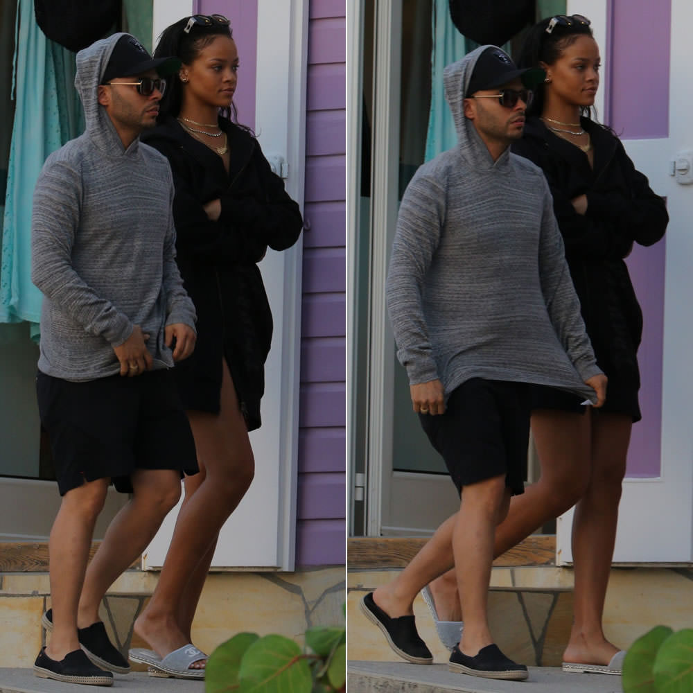 Rihanna wearing Trapstar heavy weight elongated hoodie, Jean Paul Gaultier vintage sunglasses, Chanel grey terry cloth slides
