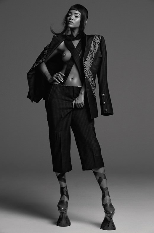 Rihanna in AnOther magazine wearing Comme des Garcons Spring 2015 menswear pinstripe suit and Givenchy vintage leather Chopine shoes