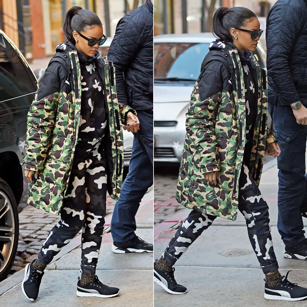 Rihanna wearing Puma x A Bathing Ape camouflage jacket, Christopher Kane camouflage sweatpants and sweatshirt, Puma Carson running shoes, Stance Street Cat leopard print socks
