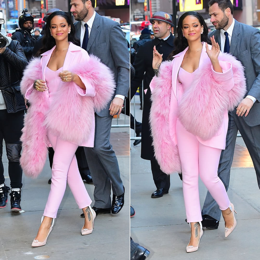 Rihanna wearing Pascal Millet Fall 2015 pink coat, stirrup jumpsuit and boa, Dior Mise en Dior tribal earrings and Christian Louboutin pumps on Good Morning Americ