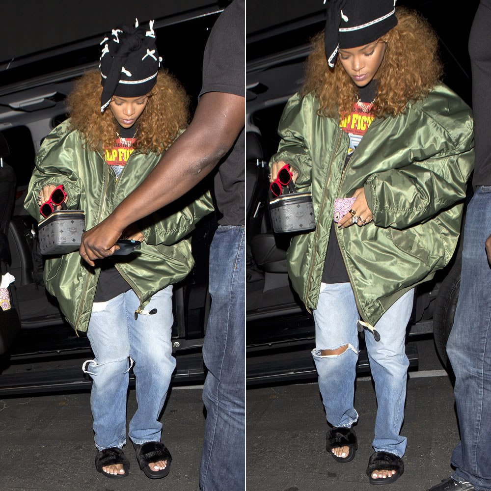 Rihanna wearing Adam Selman bow tie-top beanie hat, Vetements oversized bomber jacket, Pulp Fiction t-shirt, Puma fur slides, MCM cosmetics case