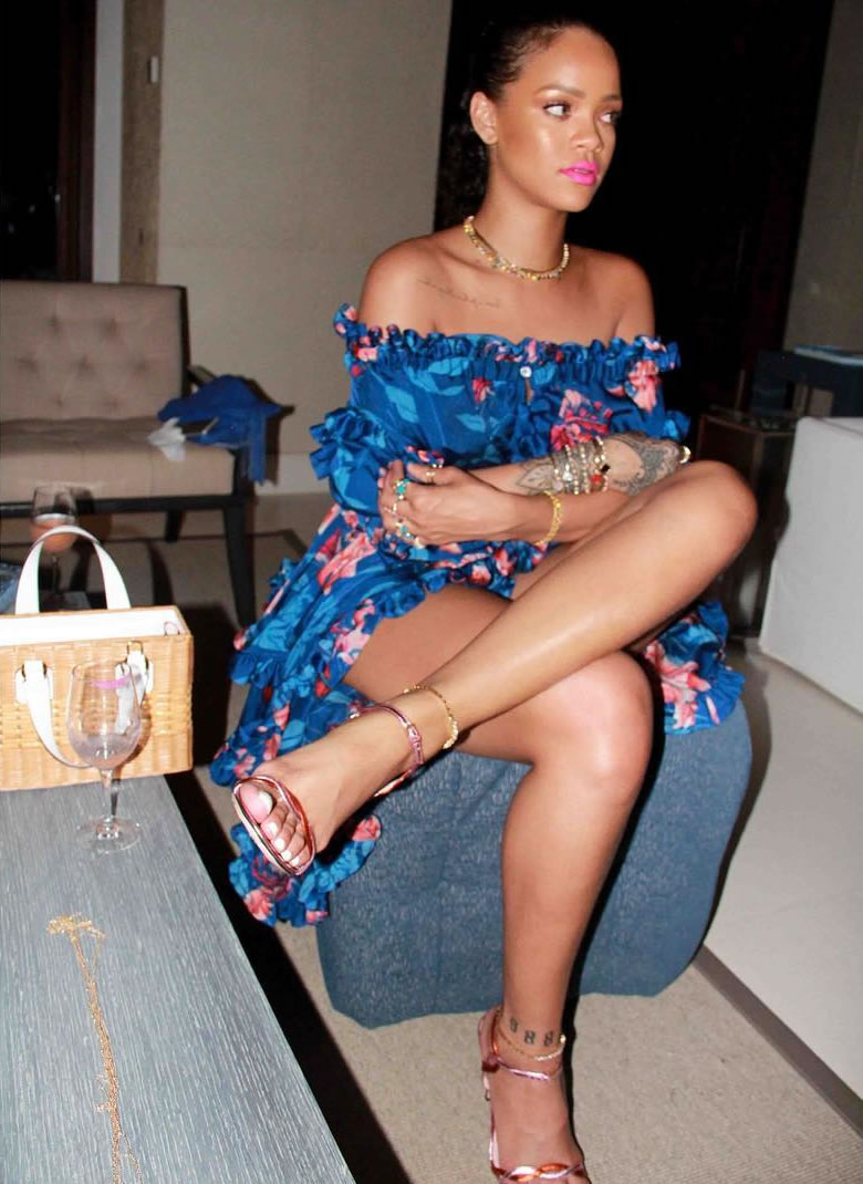 Rihanna Faith Connexion off-the-shoulder floral print blue dress, Gucci two-tone pink red sandals, Mark Cross rattan Manray handbag