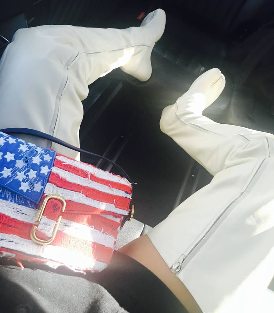 Rihanna Maison Margiela vintage Tabi thigh-high boots split toe, Marc Jacobs American flag handbag
