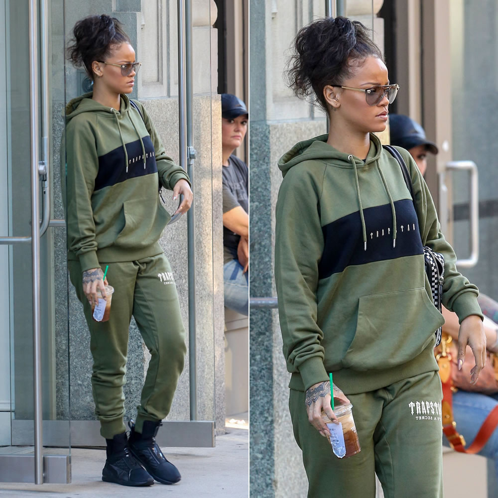 Rihanna Trapstar olive panel hoodie and side panel sweatpants, Puma by Rihanna black Trainer sneakers, Versace Lense aviator sunglasses