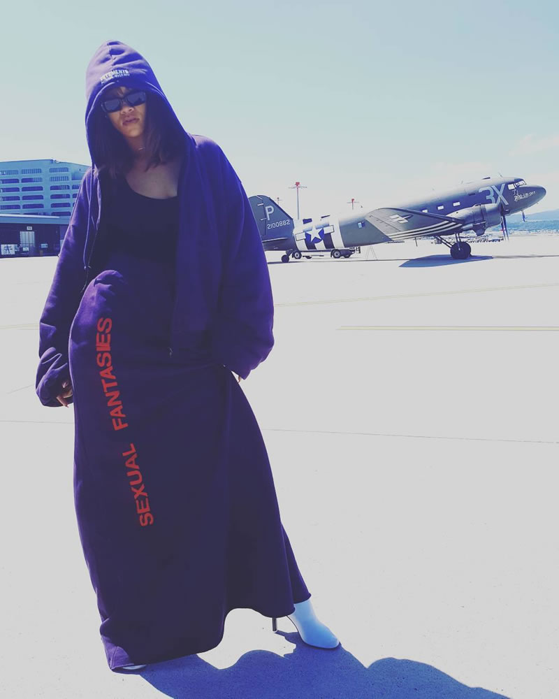 Rihanna Vetements sexual fantasies skirt, purple hooded bomber jacket, white sock boots