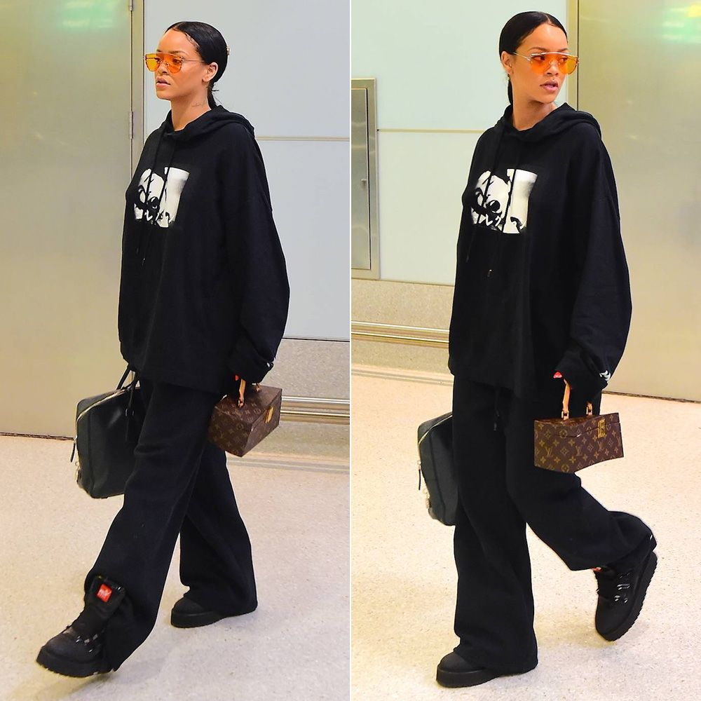Rihanna Fenty Puma rubberized boots, graphic hoodie, triple band sweatpants, Gentle Monster x Opening Ceremony Zhora Ori sunglasses, Prada Saffiano padlock briefcase, Louis Vuitton Twisted Box handbag