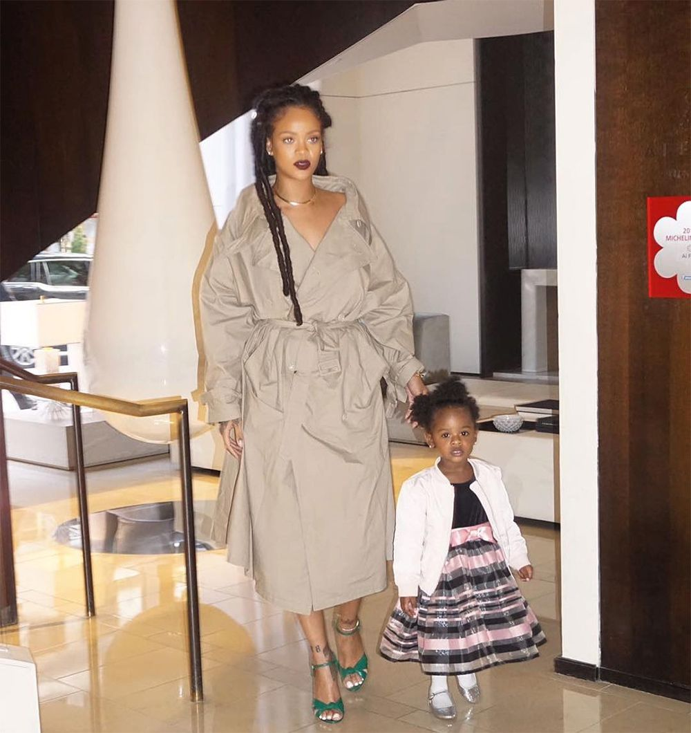 Rihanna Vetements oversized trench coat, Gucci Allie green knotted front leather sandals