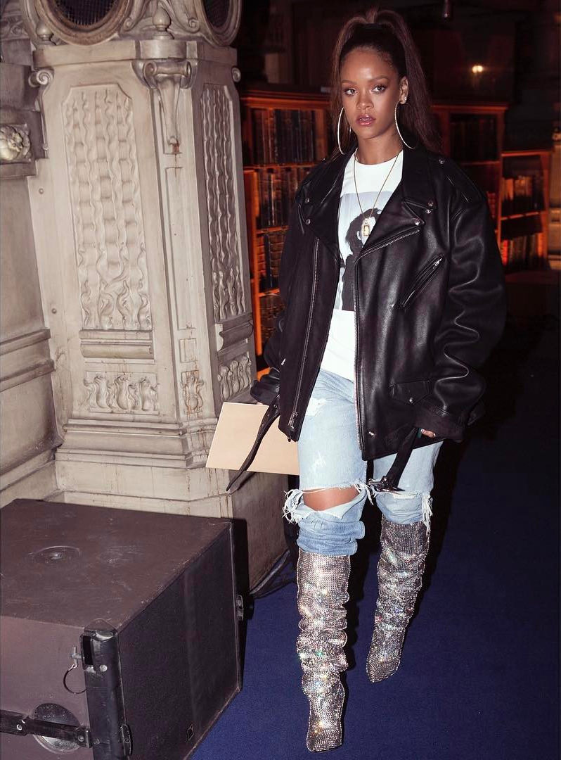 Rihanna Saint Laurent crystal boots, Schott NYC classic Perfecto leather jacket, Raf Simons Patti Smith sweatshirt