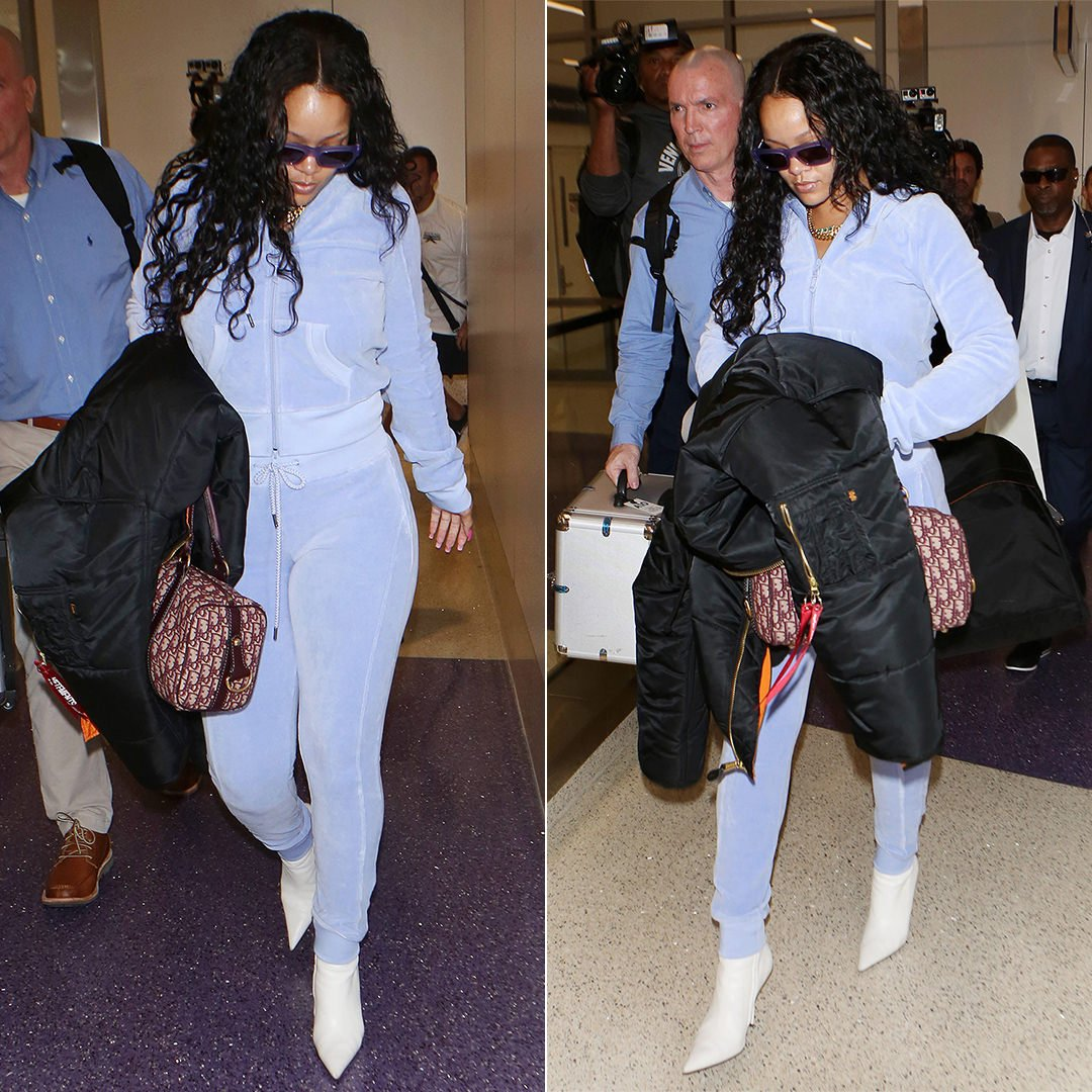 Rihanna Fenty Puma velour hoodie and track pants, Balenciaga white ankle boots, Vetements x Alpha Industries black bomber jacket, Dior handbag