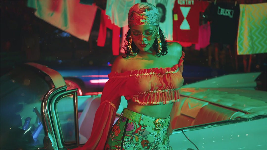 Rihanna DJ Khaled Wild Thoughts music video Karen Walker Love Hangover sunglasses, vintage Betsey Johson off shoulder top from Gabriel Held, vintage Versace green croc belt, Balenciaga Spring 2017 floral leggings and knife boots, Lynn Ban spiked hoop earrings