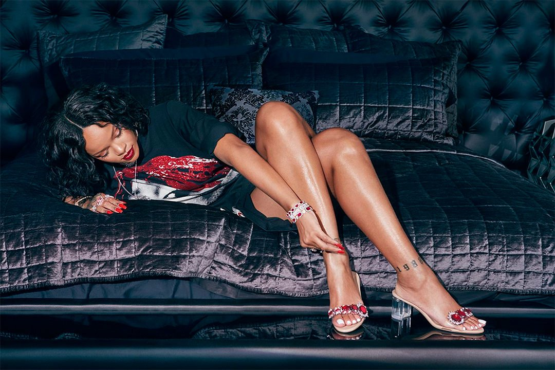 Rihanna Manolo Blahnik So Stoned Spice sandal, Pasquale Bruni diamond cross, Dvani ruby and diamond bracelets, Le Vian amethyst ring, Hearts on Fire aerial diamond bracelet and ring