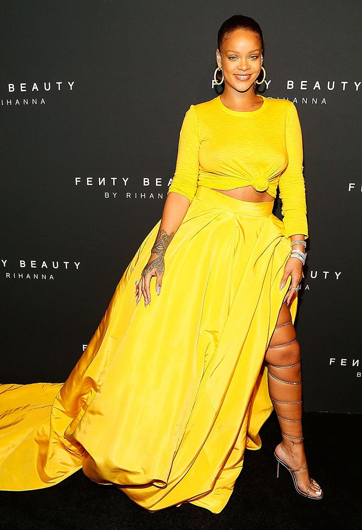 Rihanna Fenty Beauty Launch yellow Oscar de la Renta dress, gold Rene Caovilla sandals, Jacob and Co hoop earrings, Etho Maria diamond bracelet, Chopard rings