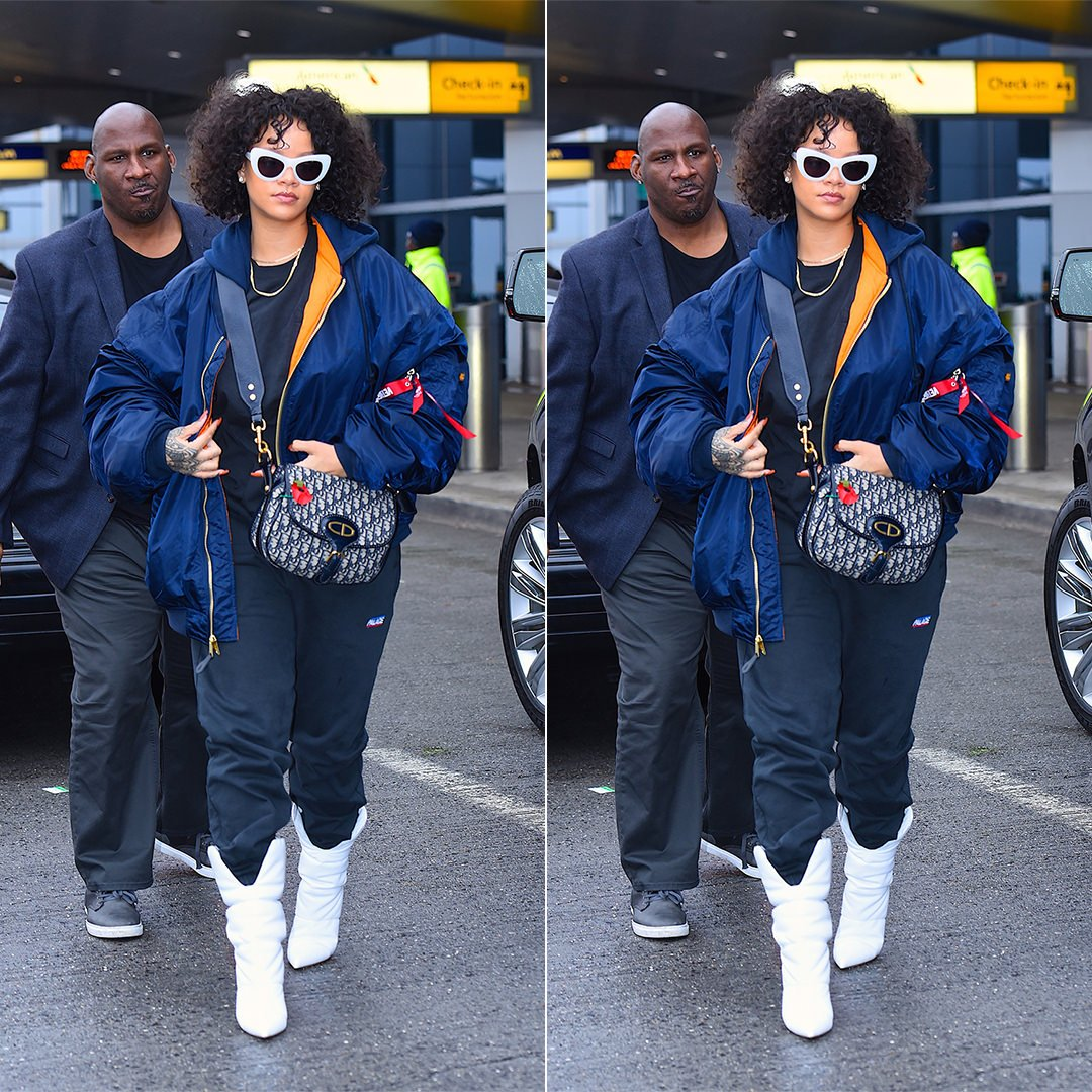 Rihanna Vetements Alpha Industries blue hooded bomber jacket, Palace Skateboards logo jogger, Off-White x Jimmy Choo white padded boots, Dior oblique saddle bag