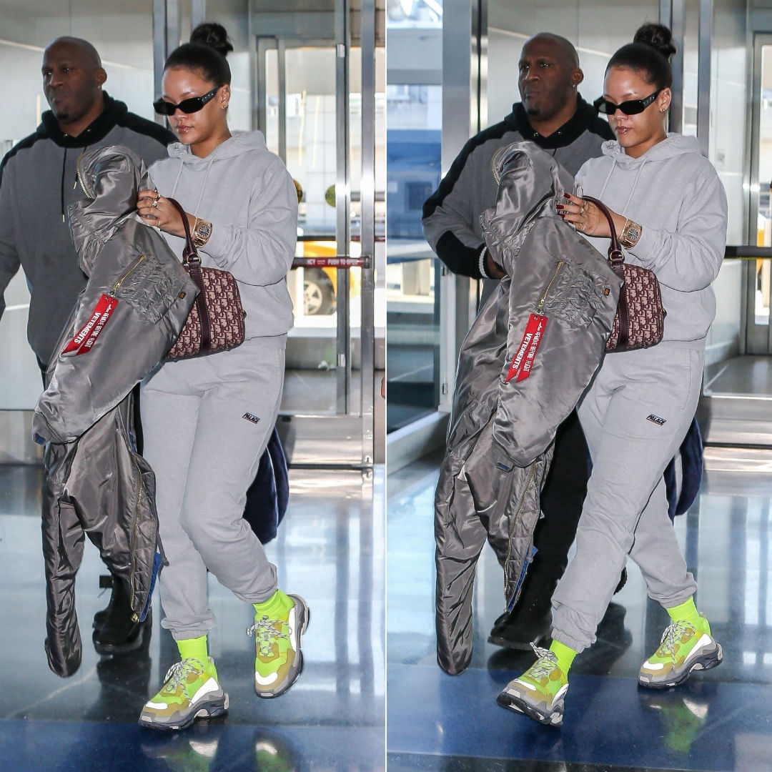 Rihanna Balenciaga yellow sneakers Triple S, Palace Skateboards grey Basically a hoodie and jogger, Vetements x Alpha Industries grey reversible bomber jacket, Dior vintage duffel bag, Patek Philippe Nautilus watch
