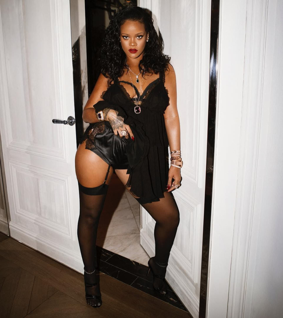 Rihanna Savage Fenty Launch Tom Ford black ruffle dress, Manolo Blahnik Andena strappy mule sandald, David Webb Couture cuff, XIV Karats pearl and diamond anklets, Savage Fenty open cup bra and lace shorty