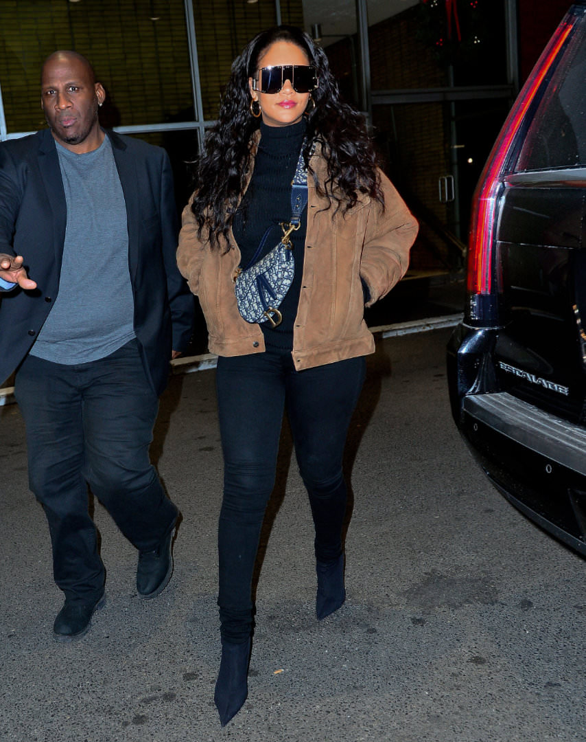 Rihanna Amiri shearling jacket, Dior oblique saddle bag mini, Citizens of Humanity Avedon black skinny jeans, Balenciaga black Knife ankle boots, Fenty shield sunglasses