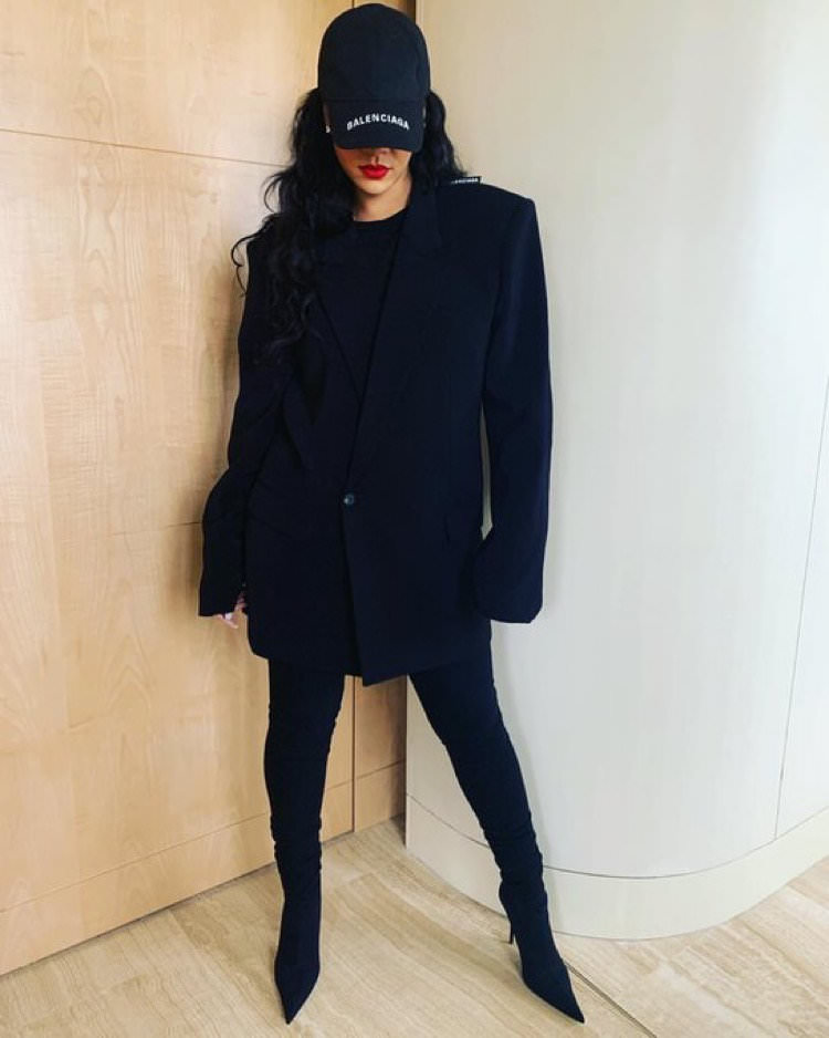 Rihanna Balenciaga black logo hat, strong shoulder jacket and Knife ankle boots