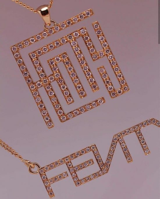 Maison Raksha custom pave diamond Fenty logo necklaces as seen on Rihanna