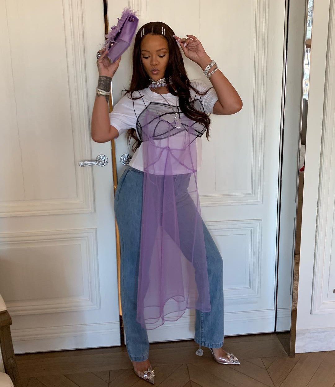 Rihanna Quetsche tulle cotton tee, Andy Wolf x KM20 Olga white crystal sunglasses, Matthew Adams Dolan high-waist jeans, Amina Muaddi Begum PVC pumps, Sue Gragg purple jade necklaces and rings