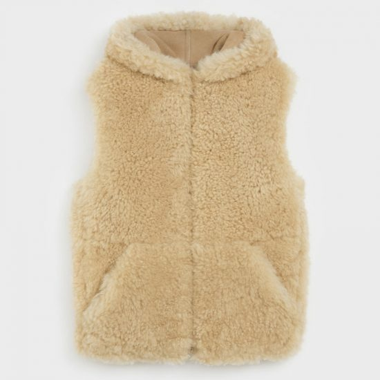 Celine shearling vest sleeveless hooded jacket as seen on Rihanna