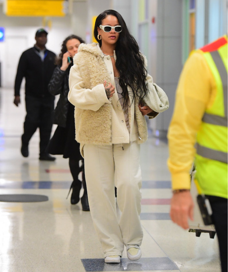 Rihanna celine shearling vest, Acne Studios ocilia beige jacket, Off-White drawstring sweatpants, Nike x Off-White Air Jordan 1 sneakers, Versace vintage sunglasses, Bottega Veneta the pouch crocodile leather handbag, djula sliced diamond necklace