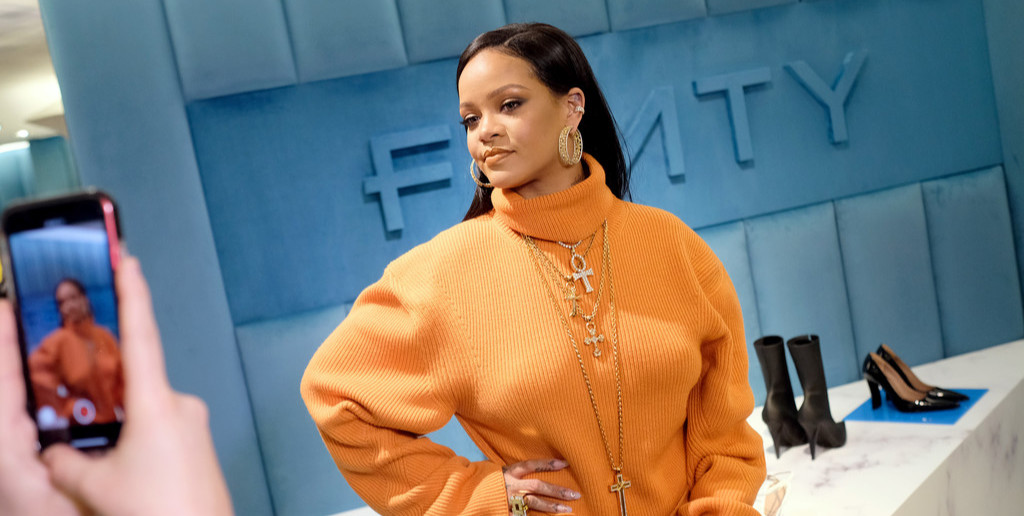 Rihanna Fenty orange coat, sweater dress and Parachute boots, Chrome Hearts cross necklaces, David Webb cubist ring, Melissa Kaye Aria diamond ear cuff, Sue Gragg hoop earrings, Shay black diamond heart ring