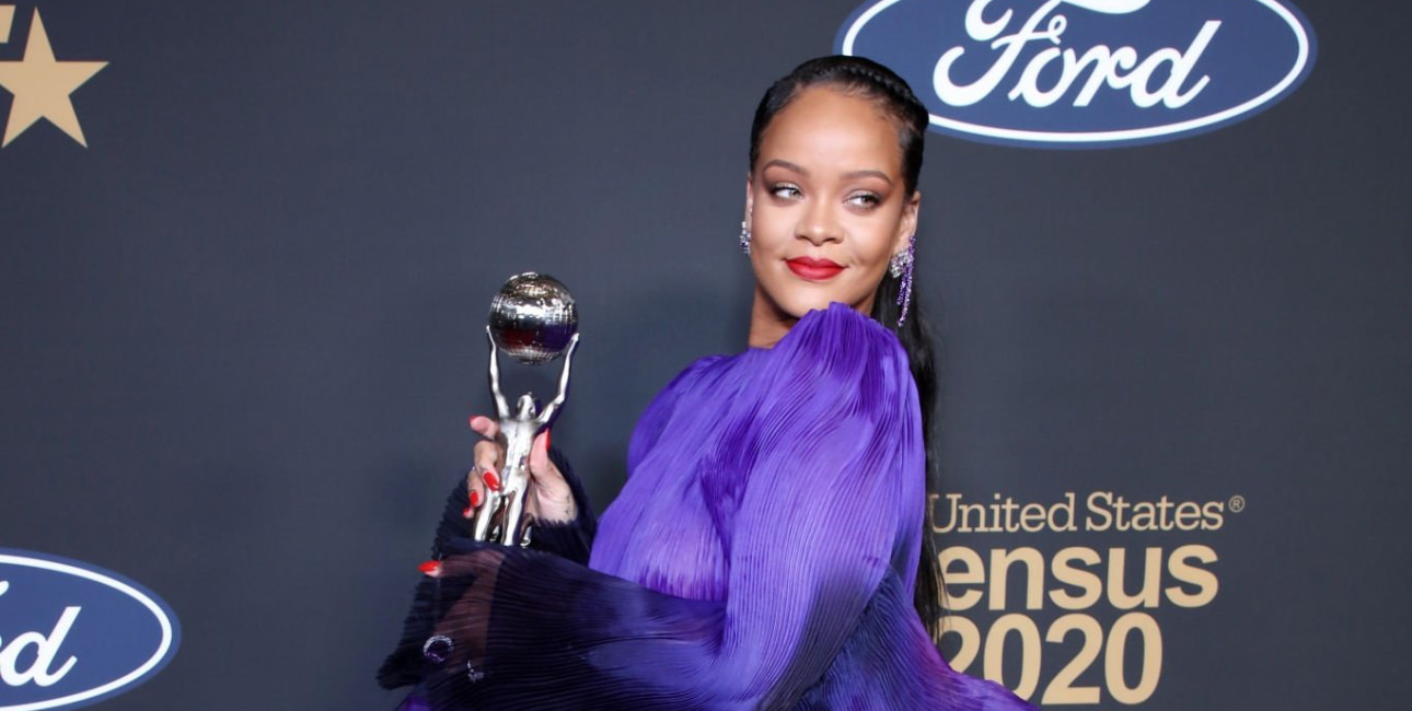 Rihanna purple gown NAACP image awards Givenchy Spring 2020 couture ruffle dress, Manolo Blahnik satin ankle wrap sandals, Chopard Tempations earrings, amethyst earring, purple spinel ring and Happy Sport watch, Kallati purple cocktail ring